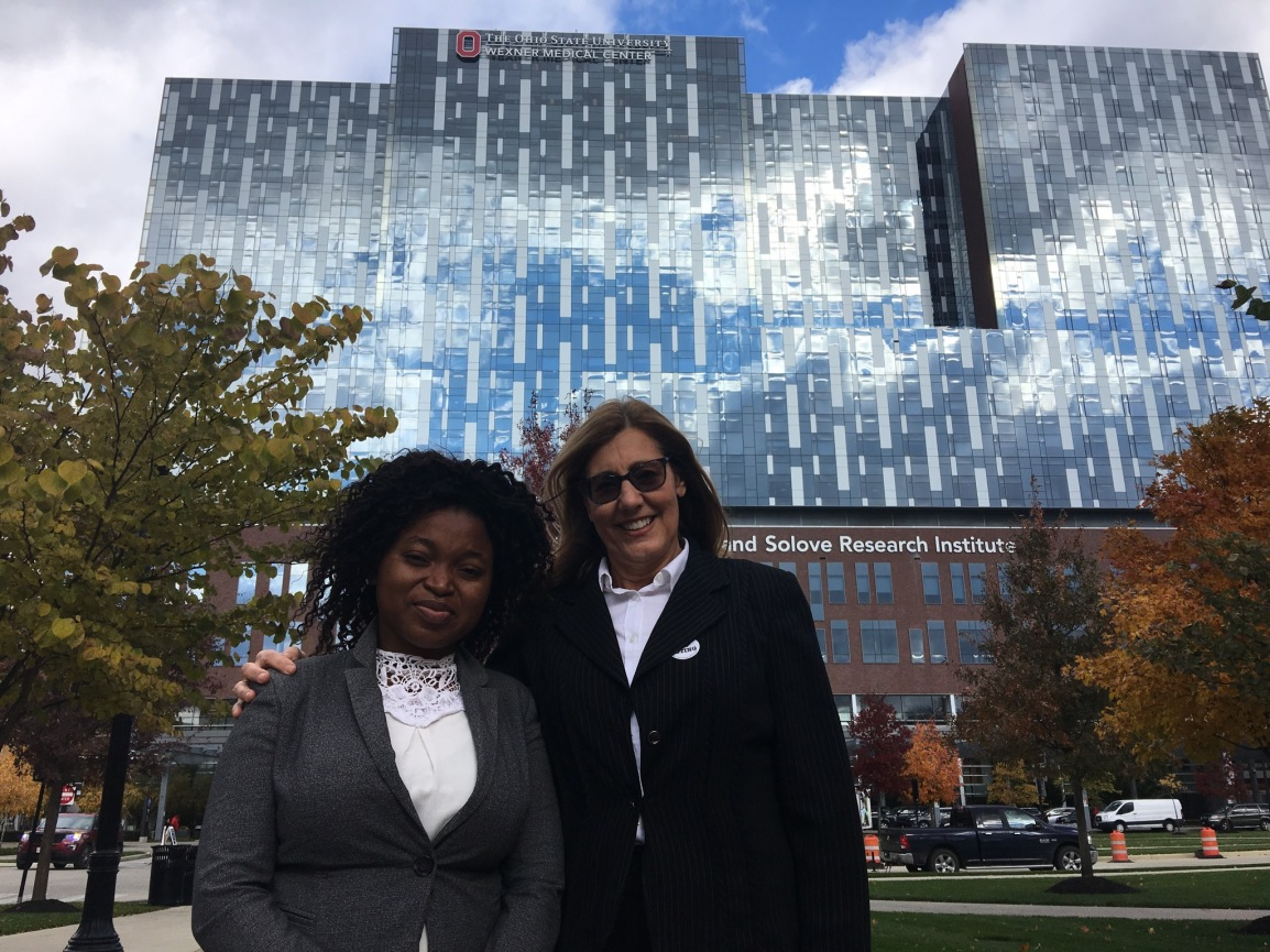 Gwaliwa and Margo in front of the Wexner Medical Center