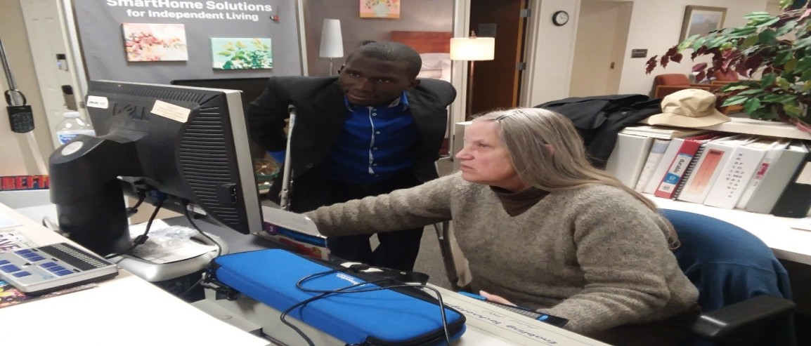 Allan learning about software for visual & hearing impairmen.jpg